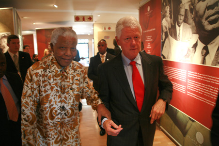 President Bill Clinton and Mr Nelson Mandela viewing the Making Peace exhibition