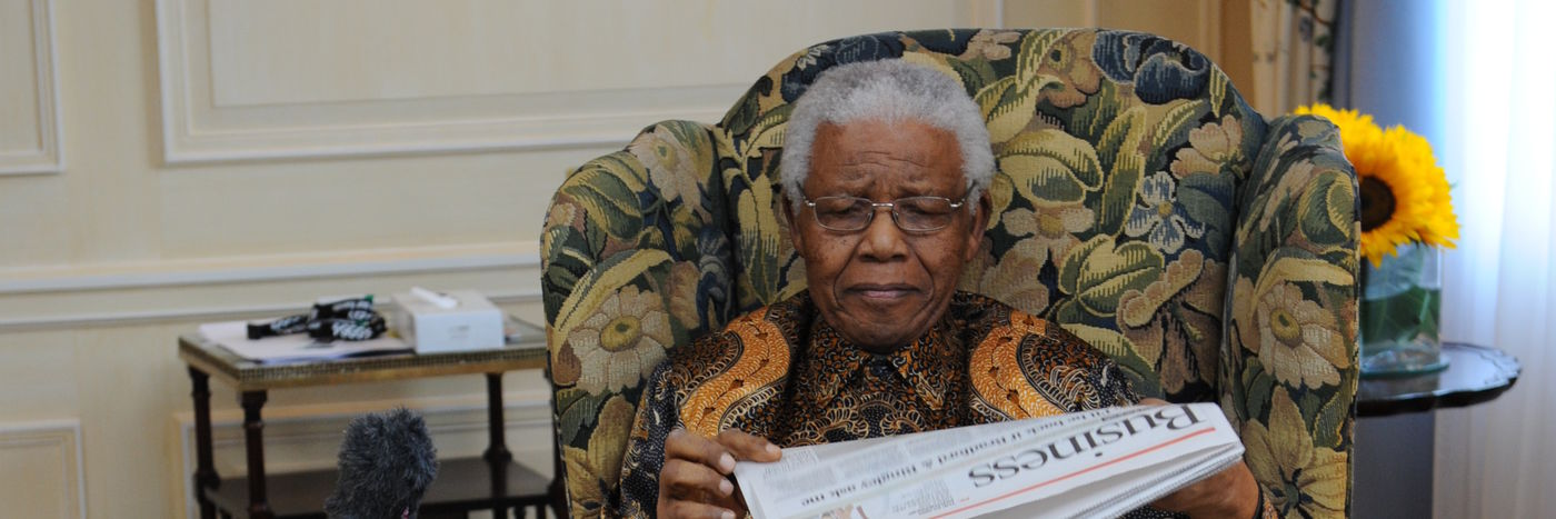 Nelson Mandela reading a newspaper