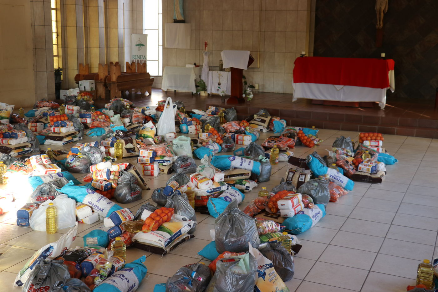 Piles of food parcels at an E1 F1 food distribution at Bodibe