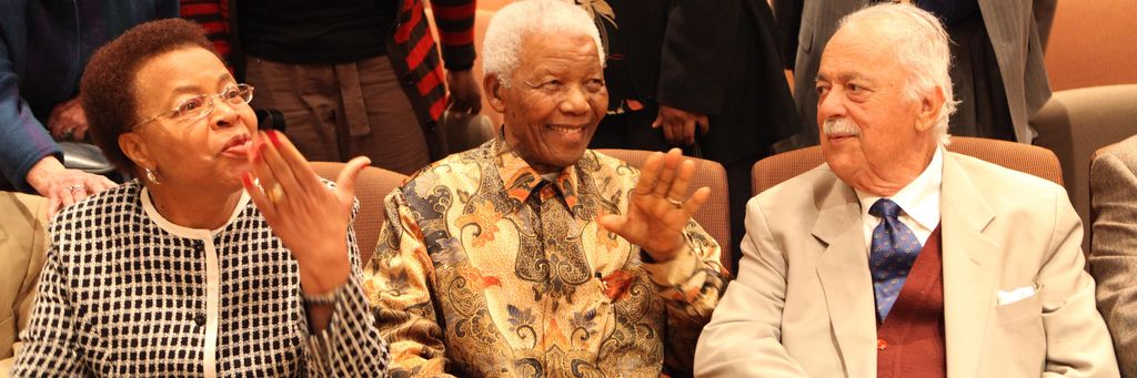 Graca Machel, Nelson Mandela and George Bizos at a Nelson Mandela Foundation event