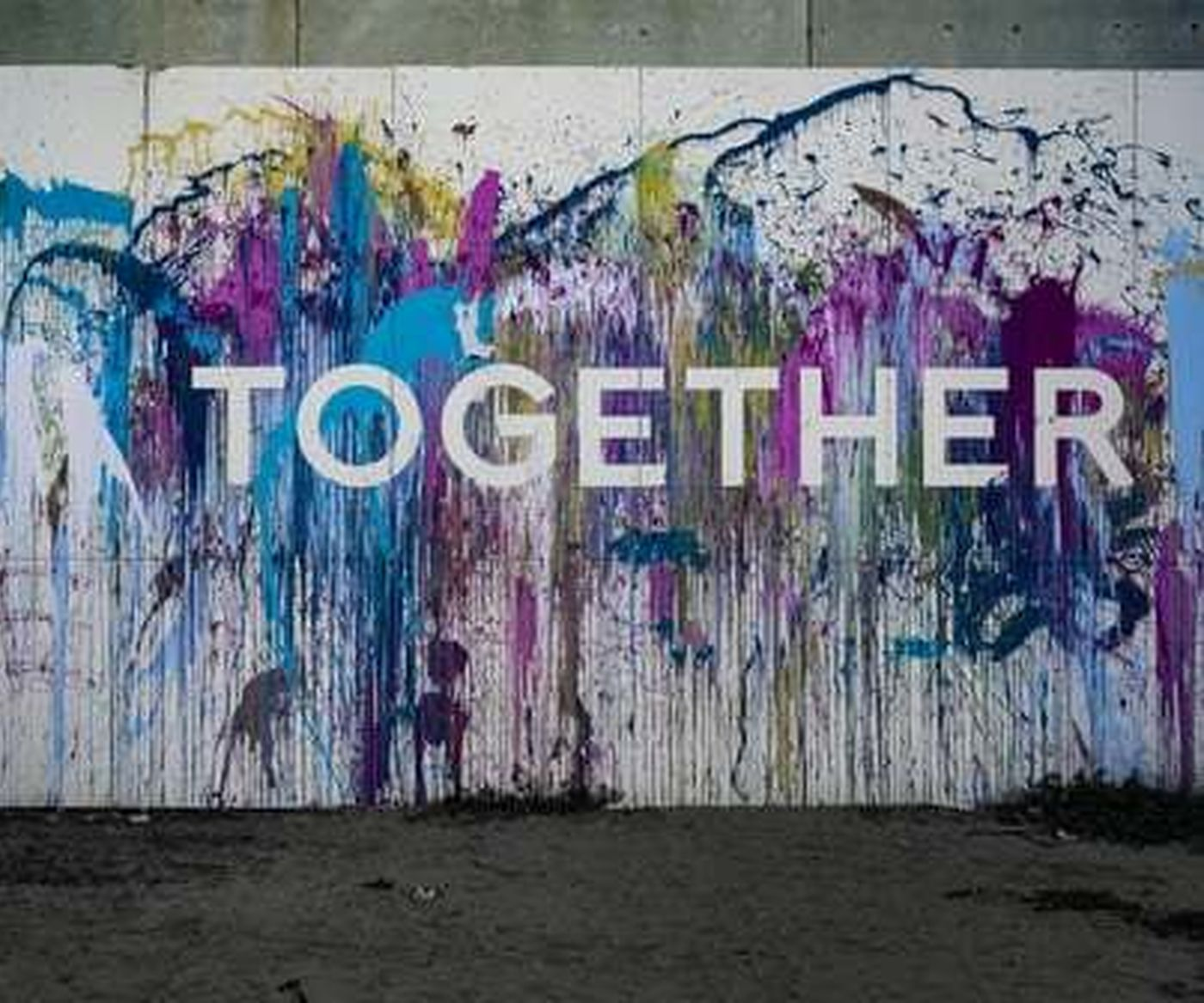 "Mural with ""together"" emblazoned on a wall"